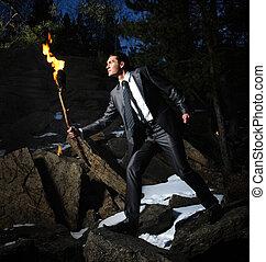 Courageous leader - Image of elegant man holding burning...