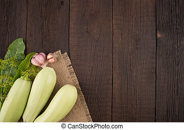 Courgettes on an old wooden table.