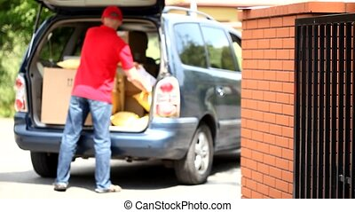 Courier and car full of packages