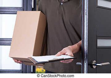 Courier asking for a sign - Courier asking customer for a ...