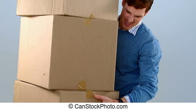 Courier man picking up cardboard boxes 4k - Courier man...