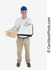 Courier man with package holding out clipboard