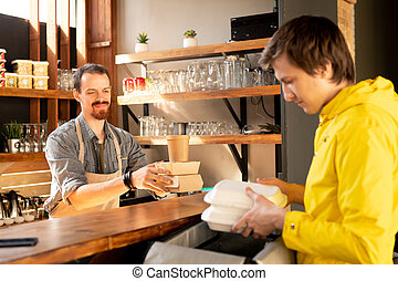 Courier taking order in cafe