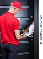 Courier waiting for a signature