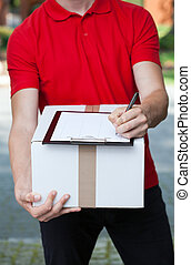 Courier writing a transport document