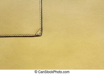 couro, fundo amarelo, costura