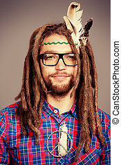 course - Portrait of a hippie young man in spectacles.