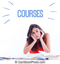 Courses against stressed student at desk - The word courses...