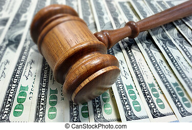 court gavel and money - court gavel on $100 bills - legal...