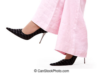 Court shoes - Black court shoes and pink trousers on white...