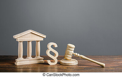 Courthouse, gavel and a paragraph symbol. International Court. Protection of business interests and human rights. intellectual property. Justice and legitimacy. Lawmaking. Judicial system