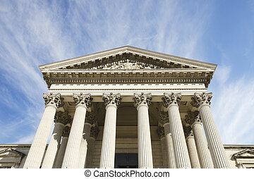 courthouse on a stunning sky - courthouse with columns on a...