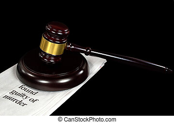 courtroom gavel on newspaper