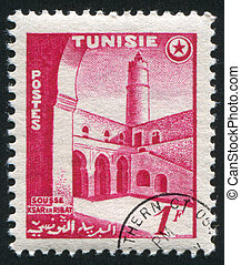 Courtyard at Sousse - TUNISIA - CIRCA 1954: stamp printed by...