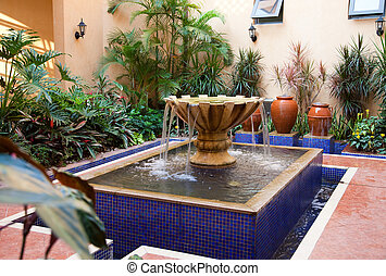 Courtyard Fountain - Plant and fountain in a new-style ...