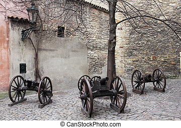 Courtyard in Gold Lane with old cannons, Prague castle,...