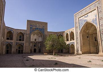 Courtyard of Abdullah-khan madrasah in Kosh-Madrasah...