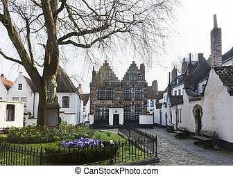 Courtyard of Kortrijk Beguinage, Belgium. - The statue on...