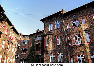 courtyard of old brick buildings of the former mining district of Silesia, Nikiszowiec, Katowice