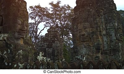 Courtyard with Ancient Stone Sculptures at Bayon Temple in...