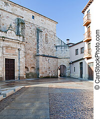 Courtyard zamorano with old building on one side and an ...
