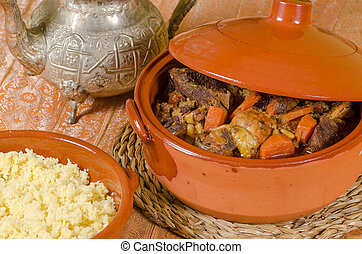 Closeup take of fresh couscous in traditiional clay pots