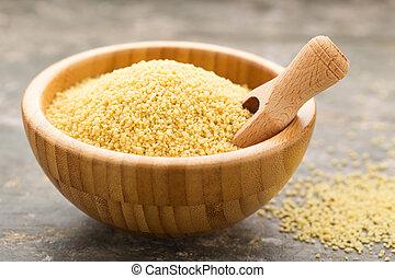 Couscous - Uncooked couscous in a wooden bowl