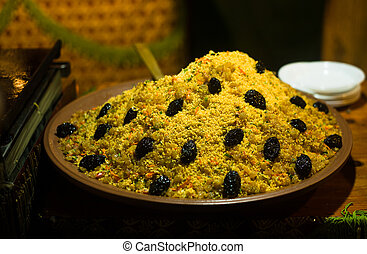 Couscous with dried plums - Large bowl of couscous with...