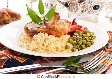 Couscous with green-stuffs and Arabic tableware, east ...