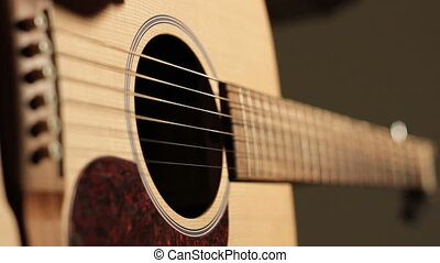 coustic guitar tuning - Close up shot of a man's hand...