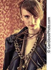 Fashion shot of a beautiful model over vintage background.