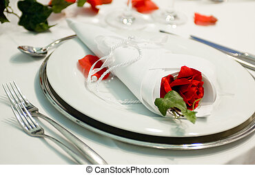 Covered banquet with red roses