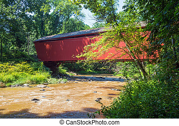 The historic Jericho Covered Bridge crosses Little Gunpowder Falls in Harford County Maryland.