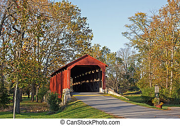 Pool Forge Covered Bridge in evening sunlight, Lancaster County, Pennsylvania, USA.