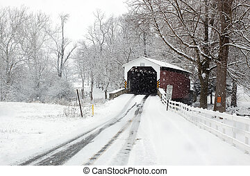 Covered Bridge in Snow - Snowing at a covered bridge in...