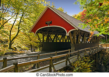 New England covered bridge in red located in northern New Hampshire