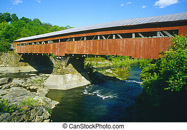 Covered bridge painted red in Taftsville, Vermont, USA