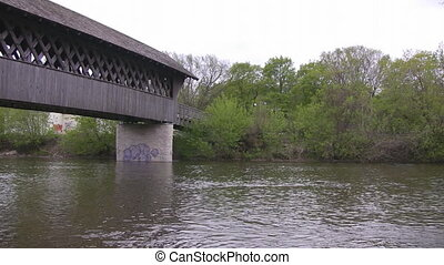 Covered bridge pan from the river below