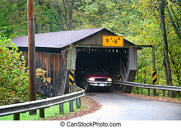 Pick up truck pasing through a covered bridge in Ohio