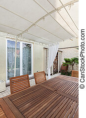 Covered patio with garden furniture