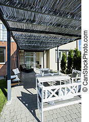 Covered terrace in front of house
