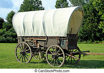 Covered wagon with a beautiful landscape background.