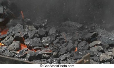 Covering glowing embers with coal