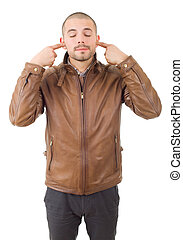 covering his ears - portrait of handsome young man covering...
