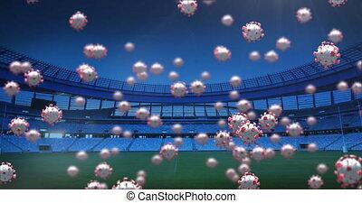 Animation of 3d coronavirus cells floating over empty stadium. Global Covid 19 coronavirus pandemic sport concept digitally generated image.
