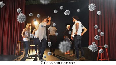 Covid-19 cells against group of people performing skit - ...