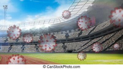 Animation of coronavirus cells floating over empty stadium. Global Covid 19 coronavirus pandemic sport concept digitally generated image.