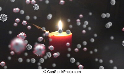 Covid-19 cells moving against hand lighting a candle - ...