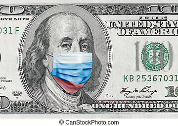 COVID-19 coronavirus in USA. Hundred golden dollar money bill with face mask.
