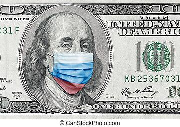 COVID-19 coronavirus in USA. Hundred golden dollar money bill with face mask.